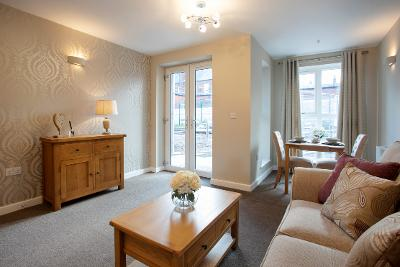 image of the lounge in a Primrose Gardens apartment